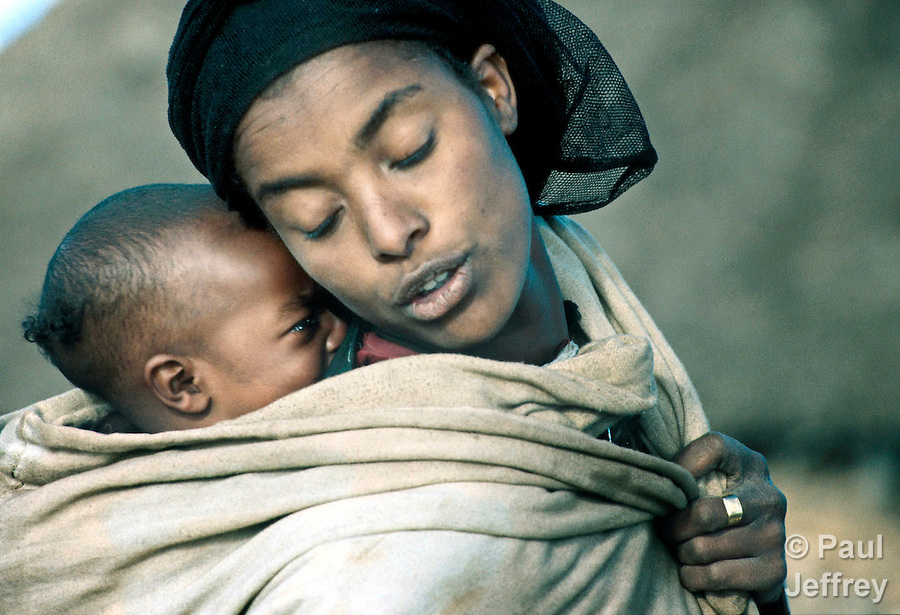 Ethiopia woman calms hungry child