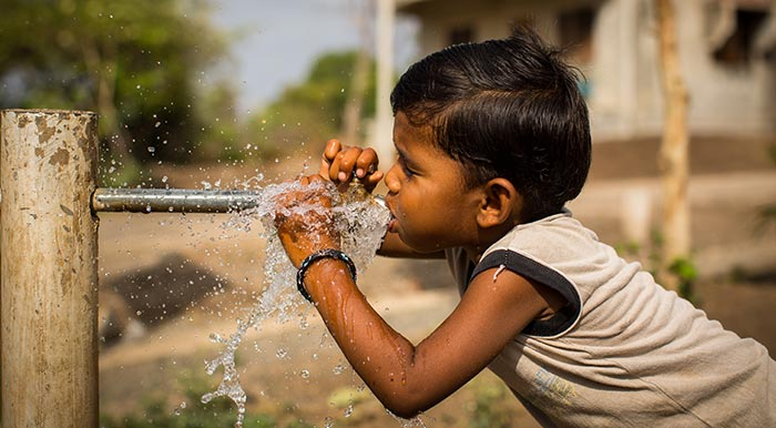 boy-drinking-water-from-a-pipe